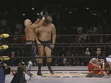 Hogan Hits Belt On Giant's Head